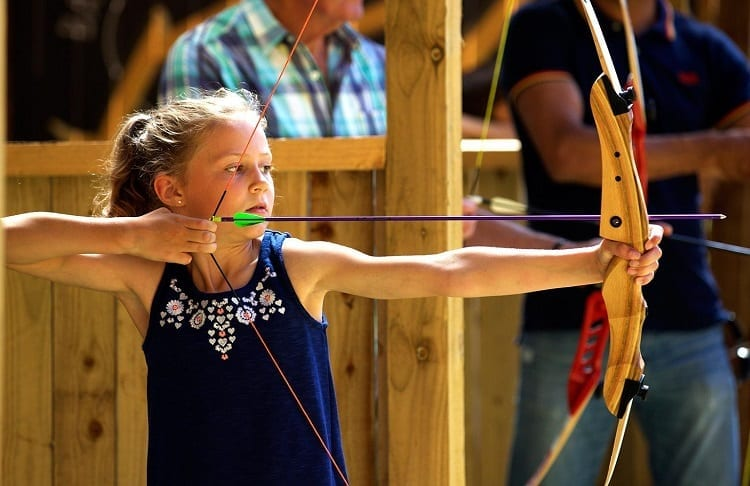 Young Girl Using Archery Bow