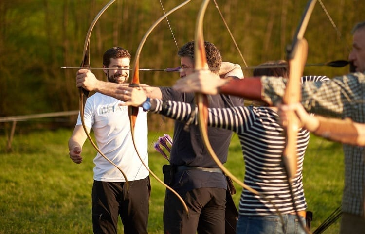 Group Of People On Archery Training